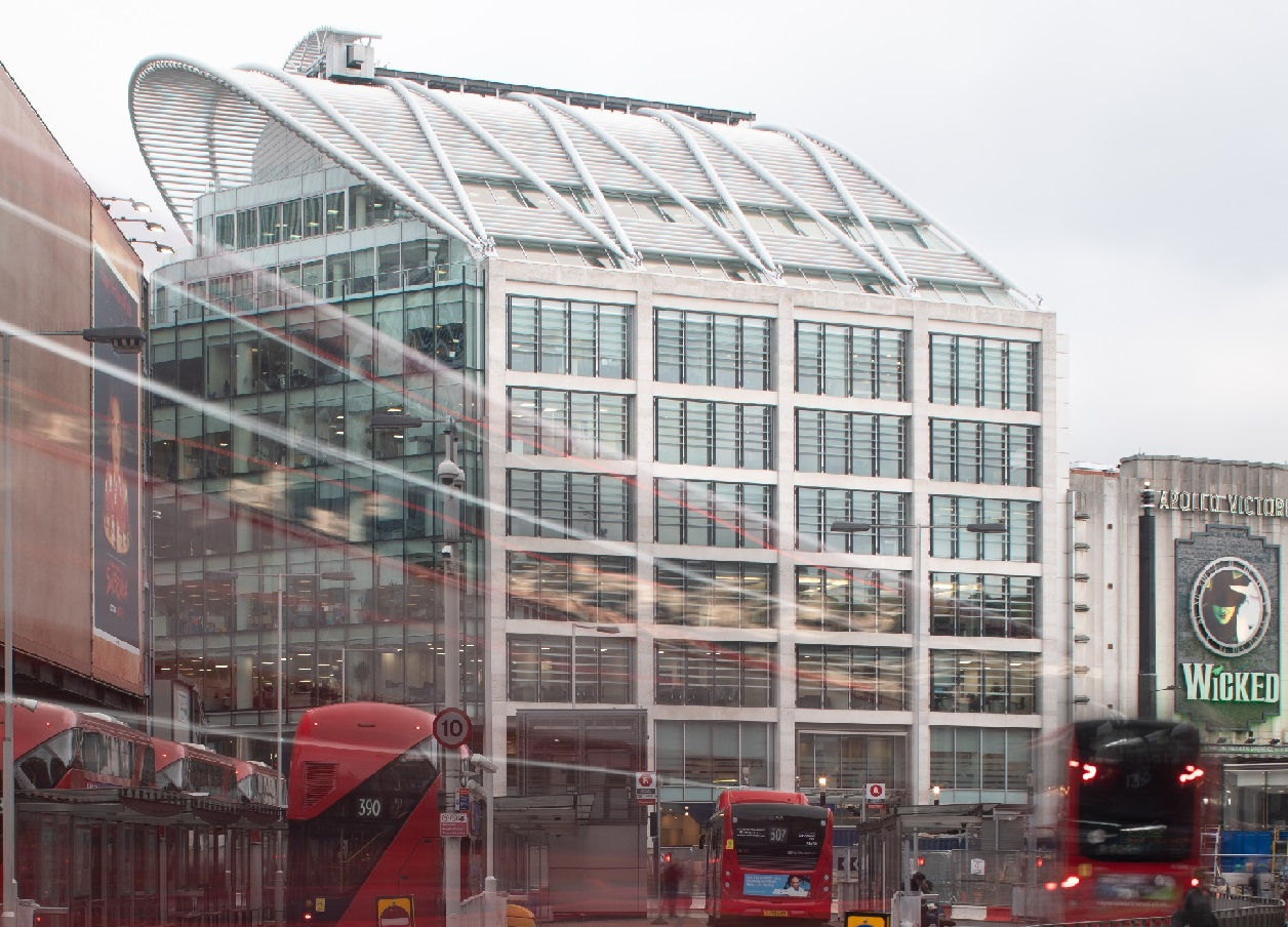 Augusta Ventures London Office from outside with all 8 floors and moving vehicles it blur effect and red London buses