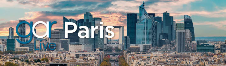 Skyline of Paris at sunset with text in the foreground of gar and Paris