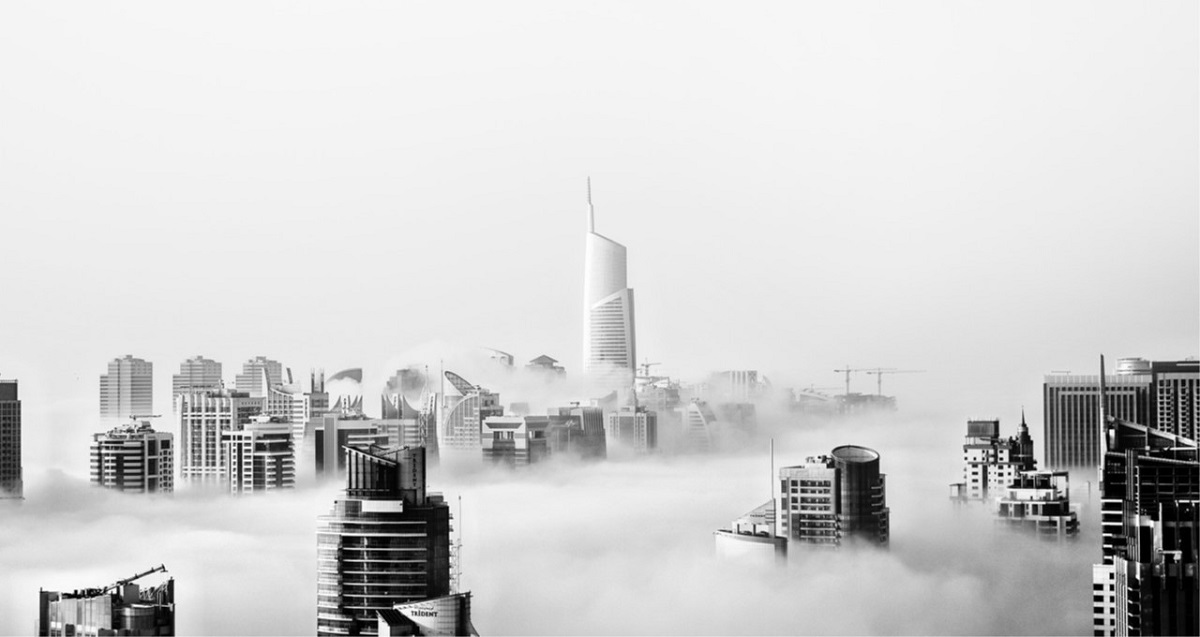 black and white skyline view above the clouds of a united Arab emirates cite