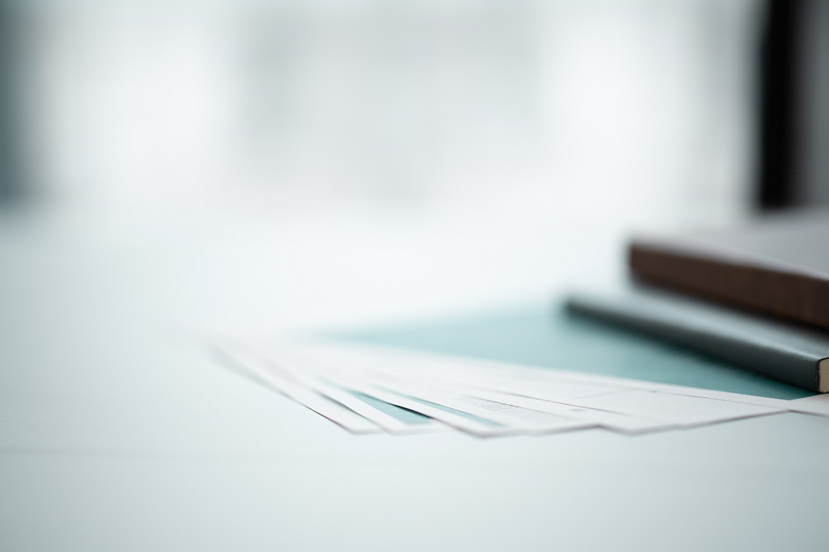 professional photography of slightly out of focus notebooks and coloured blue paper on an office desk