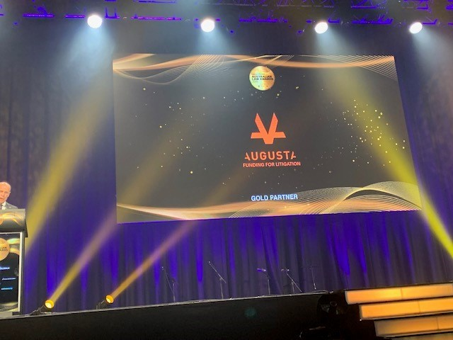 Stage and projection at awards show with Augusta Logo in the centre